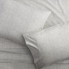 Shop graph percale sheet sets.   Grey grid squares up a graphic print in comfy 250-thread-count cotton percale.  Set includes flat sheet, fitted sheet and two cases with clean envelope closures.