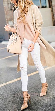 #spring #outfits  woman on brown coat with white denim jeans outfit. Pic by @vogue__worldwide
