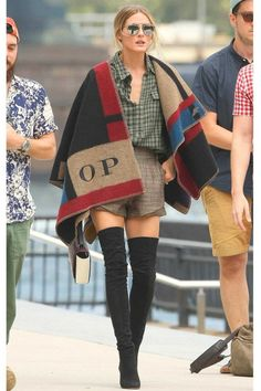 """Pinned for the boots. Olivia Palermo in Burberry in New York   Vogue Australia   """"I loved the customised shawls shown at the Burberry show in London. Looks like Olivia was lucky enough to get one of her own."""" – Edwina McCann, editor-in-chief"""""""