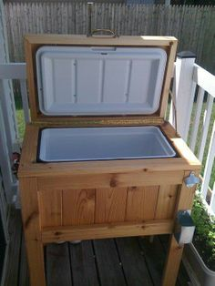 dress up a simple cooler for your patio or deck - to match the table with the beer trough in the middle