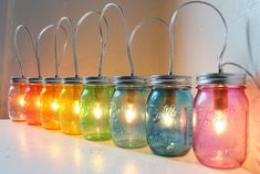 Rainbow PARTY LIGHTS - Mason Jar Banner Lighting Fixture with 8 jars - Upcycled Rustic Wedding Holiday string of Lights - via Etsy.