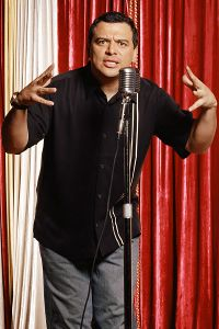 """""""You see this microphone? I am controlling it with my mind.if I wave my hands like this it makes me sound like this (high squeaky voice), but if I wave them like this I sound like this (really low voice. Honduras, Carlos Mencia, Fresno California, Social Class, Dee Dee, Stand Up Comedy, Comedy Central, Criminal Justice"""