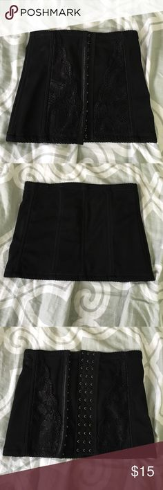 Black Waist Corset Never Worn NWOT This is the same waist corset you see on everyone and sells online for crazy prices. It is a Lycra waterfall with industrial strength boning in 7 places, 13 Hook and Eye closures to fit waists up to 31 inches. With three sets of closures to make the sizing smaller as your waist becomes thinner. This is a true med. And is best for those with a waist of 31 or less No Tag Accessories Belts