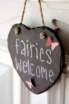 Someday I want to decorate a little girls room w woodland fairy decor. This could go on the door.