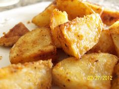 Healthy oven roasted potatoes with garlic, onion, and paprika.