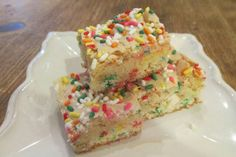 1 box funfetti cake mix, 1 stick butter melted, 1/2 cup milk, 2 eggs, 8 oz confectioners' sugar, 1 (8 oz.) pkg. cream cheese. Mix together cake mix, melted butter, milk, and 1 egg. Press into greased 9x13 pan. Mix together confectioners sugar, 1 egg, 1/2 t vanilla, and cream cheese. Spread on top of cake mixture.  Bake at 325°F for about 35 minutes. Cool completely and cut into squares.