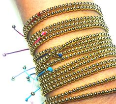 Gold Beaded Bracelets - These beautiful wax-cord bracelets are adjustable to fit comfortably on any size wrist. Get your favorite color at  www.brightbands.com