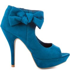 No need to spend hours deciding on what shoes to pair with your cocktail dress; The Shed An Hour will be a perfect choice. Unlisted brings you a blue fabric covered style with adorable enlarged bow at the ankle strap. A large cut out at the vamp, 4 3/4 inch heel and 1 inch platform leaves this style with perfection.