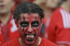 An Albanian supporter sticks his tongue out he waits for the start of the the Euro 2016 Group A soccer match between France and Albania at the Velodrome stadium in Marseille, France, Wednesday, June 15, 2016. (AP Photo/Ariel Schalit)/FP265/494801487602/1606152034