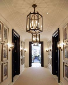 Lantern-lit and filled with art, a hallway at the Ralph Lauren Palazzo in Milan leads to one of several spectacular outdoor spaces. Lauren Hall, Hamptons Style Decor, Ralph Lauren Store, Modern Interior, Interior Design, Black Doors, Hallway Decorating, Elegant Homes, Ceiling Design