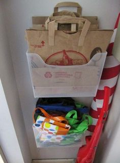 How many times have you thrown a grocery bag away only to wish you had one for trash or recyclables later? Nail a plastic file organizer on the inside of your pantry to hold paper or reusable grocery bags after a trip to the store.