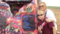 My son and I at Cadillac Ranch! Just west of Amarillo, Texas, 10 sets of graffiti-covered tail fins stand as a tribute to the American dream. The art installation, known as Cadillac Ranch, not far from the I-40 and the historic Route 66, visitors are encouraged to visit, spray paint in hand, to tag the cars.