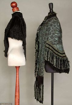 Two Victorian capes, 1870-1890; One sky blue wool, hand embroidered black chain stitch in dramatic small stylized floral pattern, blue and black chenille hem crochet and long fringe, excellent; One black velvet capelet covered with jet appliques and beaded fringe