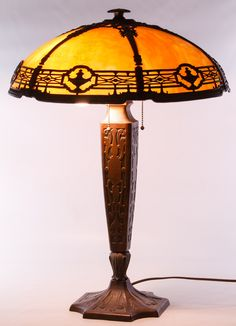 Lot 192: Art Nouveau Slag Glass Table Lamp by Bradley and Hubbard; c.1920, having brown slag glass panels, stamped maker mark by the sockets