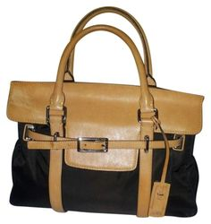 """LIGHTLY USED Rare Style Authentic Tumi Brown Nylon With Leather Trim Flap Handbag Satchel Briefcase  REAL AND AUTHENTIC.  This Handbag is Used with Minor signs of previous Use but in Excellent condition.  CLEAN WITH NO UNUSUAL SMELLS OR ODORS.  INSIDE HAS a Polka Dot Fabric LINING , ONE ZIP POCKET AND 1 SLIP POCKET      Measurements:  length: 13""""  height:10.5""""  depth:3""""  Handle Drop :3.5""""      See attached Photos as part of description.  From a smoke Free pet free home.  Don't hesitate to…"""