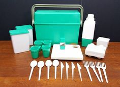The Boxter vintage plastic picnic set from the 1950s in teal green. Made in Italy. This set includes a box with a handle that locks the lid into place for easy transport. The contents include: a thermos, four plates and cups, an egg holder, (4) forks, (4) knives, (4) spoons, salt/pepper shaker, and two food containers. This set is in great condition and only shows very minor signs of wear. It measures about 15 wide, 12 1/4 tall, and 5 1/4 deep.