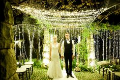 Outdoor Night Wedding couple portrait idea with awesome fairy light backdrop. Pics: Nola Photography