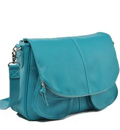 Stylish laptop and camera bag. Nikki, will you hate me if I also have a teal purse?
