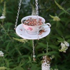 DIY Teacup Bird Feeder--could be used as feeder, bath or combo with water in cup and seed in saucer! Trip down to the thrift to find cups and saucers if you don't have some you wish to turn over to the birds.
