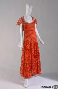 Madeleine Vionnet Evening dress c.1938 // Material: Orange cotton and silk crepe de chine //  Museum at FIT 69.159.2 // Credit: Gift of Genia Graves
