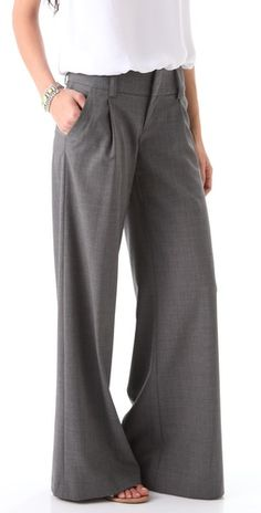 These wide-leg wool pants feature slant hip pockets and welt back pockets. Double hook-and-eye closure.