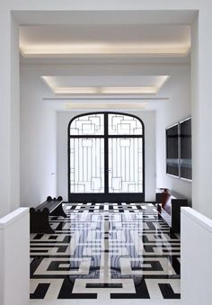 Black White entry ... . great geometric design in the door and floor