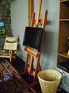 lovely idea! Art easel TV stand.