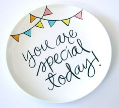 Special birthday plate Go to paint your own pottery place in your various cities and have kids and grandkids make dessert sized plates for a complete set. Each person could do different or you could choose any design but similar colors to unify, or all do handprints, his favorite things, etc... @Amy Lyons Gebhard