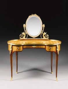 Paul Sormani (1817 - 1887) || A Louis XVI style gilt bronze mounted mahogany and satinwood parquetry dressing table, Paris, last quarter 19th century, the swiveling oval mirror held aloft by winged water nymphs, the kidney shaped table fitted with three frieze drawers.