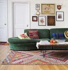Love that emerald sofa.
