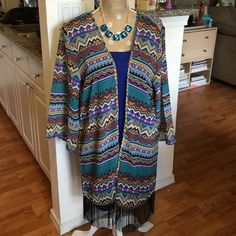 Tribal print coverall This beautiful tribal print coverup can be use on the beach or just wear over your favorite dress or with jeans have fringe at the hem of coverup size 2X fit from large to 2x She's Cool Jackets & Coats Utility Jackets