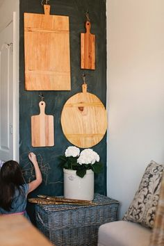 chalkboard wall hung with old bread boards.