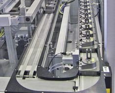 designed an LTE that features a single belt to injection valves to multiple workstations. After processing, the valves are discharged to the next station via bypass conveyors. The system is approved for clean rooms. Belt, English, Design, Belts, English Language