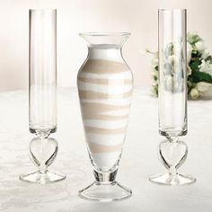 Wedding Unity Sand Ceremony Vase Set includes one main vase that holds 14 ounces and two pouring vases that hold 7 ounces.  Just choose your favorite sand colors and alternately pour into the vase for a unique design.