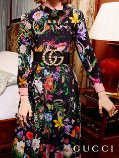 The House's storied print Flora has a contemporary twist for Gucci Cruise 2017 in rich tones on a black background with a pink serpent coiling around the pattern on a dress and a wide leather belt with the GGs studded in pearls by Alessandro Michele.