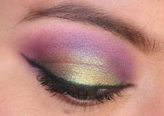 Purple and golden eyes with Milani Purple Shock, MAC Sketch, and MAC Old Gold pigment.