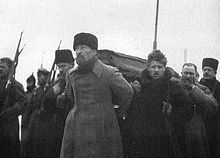 Lenin's death, 1924. Pallbearers carrying Lenin's coffin during his funeral, from Paveletsky Rail Terminal to the Labor Temple. Felix Dzerzhinsky at the front with Timofei Sapronov behind him and Lev Kamenev on the left.