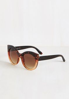 Any Wave, Shape, or Form Sunglasses. No matter how or where theyre worn, these cat-eye sunglasses guarantee to finish off your outfit with finesse! #brown #modcloth