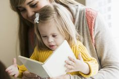 A journalist and mom of a child with Down syndrome shares some of her favorite books and websites to add to your resource pile.