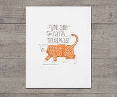 "Cat's Pajamas Letterpress Art Print JJD-LP-CPP. You're the cat's pajamas! letterpress art print will put a smile on anyone's face. This cool cat is sporting some amazing goldfish pjs and is paired with whimsical type. Great wall decor for a kids room or your bedroom. Also makes great wall art wherever your cats hang out in the house. - 8"" x 10"" - 92#, 100% cotton bright white paper - 2 colors - Ships flat in a cardboard mailer."