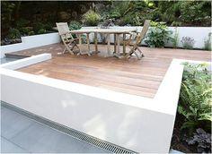contemporary garden decking area with low rendered white walls - Nina Baxter - Garden Designer