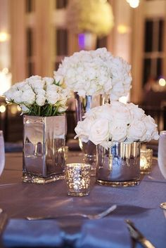 Don't know how big you are on white flowers, but I love the idea of silver mirrored vases for centerpieces.spray paint with glass look paint. Table Decoration Wedding, Wedding Table, Our Wedding, Dream Wedding, Wedding Ceremony, Ceremony Signs, Bling Wedding, Church Wedding, Fall Wedding