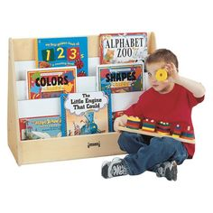Jonti-Craft's Birch Preschool Pick-a-Book Stand features three 1 deep shelves that make it easy to identify favorite titles. The back features display space for oversized books. Deep Shelves, Book Shelves, Shelf, Little Engine That Could, Counting Books, Paper Tray, Preschool Books, Book Stands, Media Storage