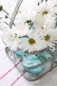 Daisies in blue mason jars French Larkspur