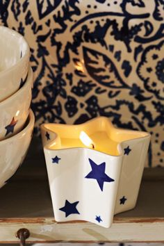 Emma Bridgewater Starry Skies Star Candle 2014. Love the Wallpaper wallpaper lining the shelf behind!
