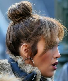 Pinterest: DEBORAHPRAHA ♥️ Jennifer Lopez bangs and bun hair style #jlo