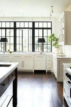 White, dark wood floors, black window casings
