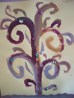 DREAM DRAW CREATE Art Lessons for Children Trees in the style of Gustav Klimt.  Children mixed warm and cool paint colors to make shades of brown, then painted them into a tree.  Jewels were added to embellish.