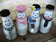 The many uses of a Starbucks Frappaccino bottle...snowmen in a jar.Paint lid with sharpee, fill the bottles with Poly-Fil for snow and used dots of Tacky glue and beads to make the faces. Bits and scraps of yarn, fabric, ribbon, and cord were used for the ties, scarves, and hats