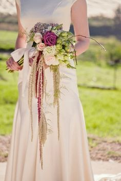 So vintage!  Perfect for a vintage-themed wedding.    12 Absolutely Gorgeous Cascading Wedding Bouquets